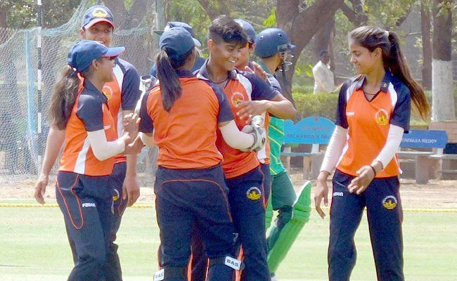 Kashvee Gautam celebrates one of her wickets during her historic spell.