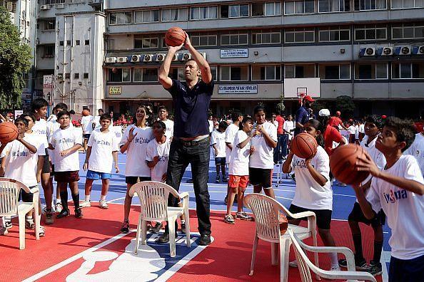 Kids from the Reliance Foundation Jr. NBA Program with Sacramento Kings legend Vlade Divac