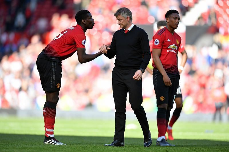 Paul Pogba and Ole Gunnar Solskjaer in the centre, Martial in the right