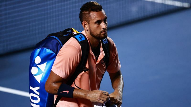 Nick Kyrgios leaves the court after retiring against Ugo Humbert