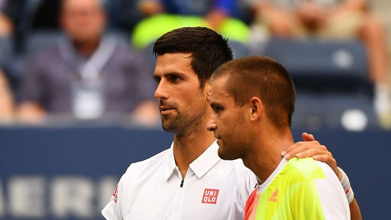 Djokovic with Mikhail Youzhny