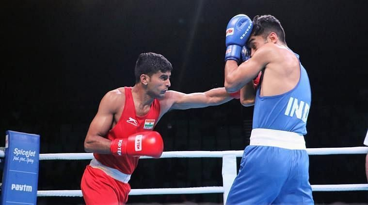 Manish Kaushik (in red) became the 9th Indian boxer to qualify for the Tokyo Olympics