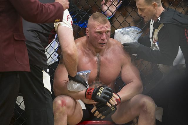Brock Lesnar receives attention during a break between rounds