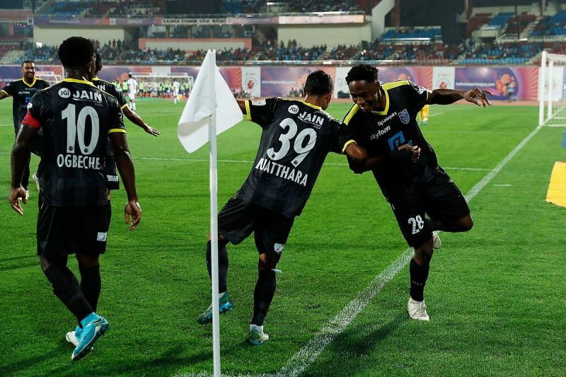 Kerala Blasters players celebrate after scoring against Odisha FC in an ISL match