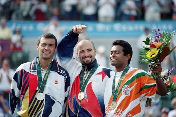 Leander Paes (R) with his Olympic bronze alongside Andre Agassi and Sergi Bruguera