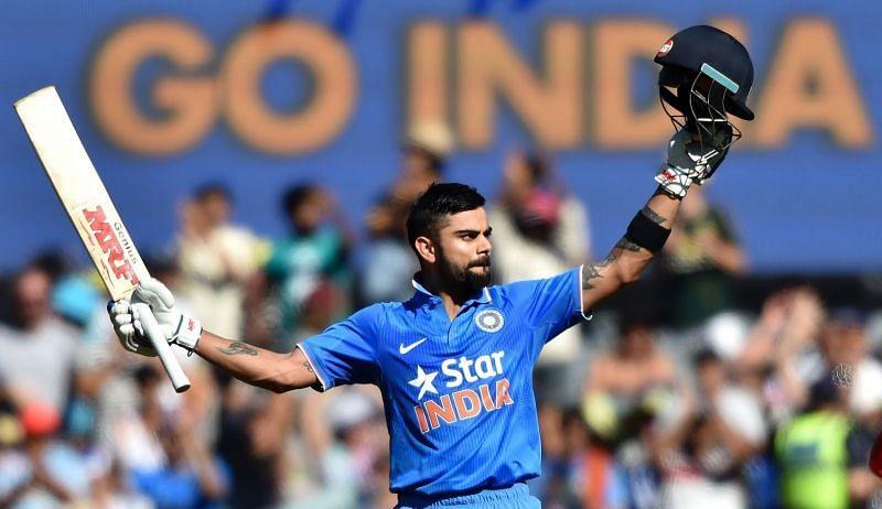 Kohli celebrates after hitting a century.
