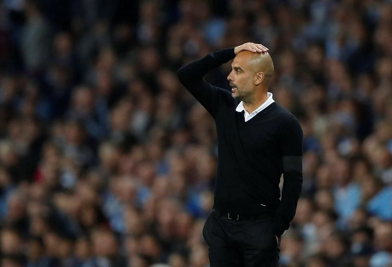 The Manchester City manager by the touchline