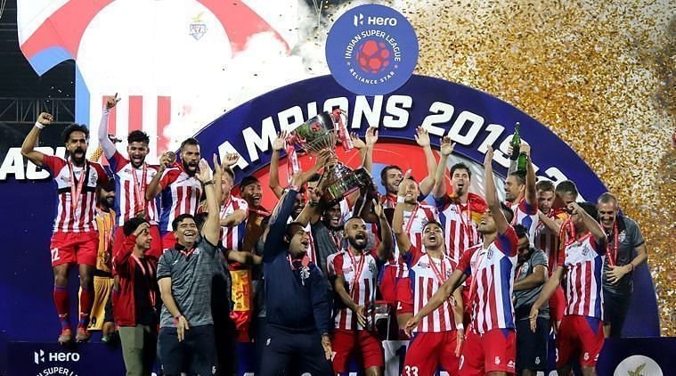 ATK players celebrate after lifting the ISL trophy