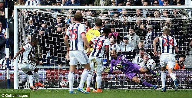 Gomes saving a Berahino penalty