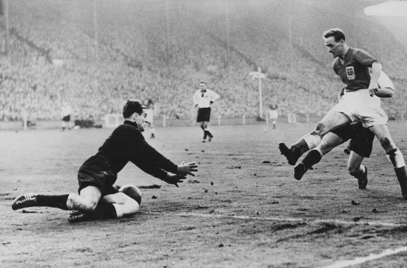 Tom Finney (R) in action for England