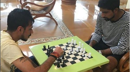 Yuzvendra Chahal (L) is seen playing chess with Is Sodhi