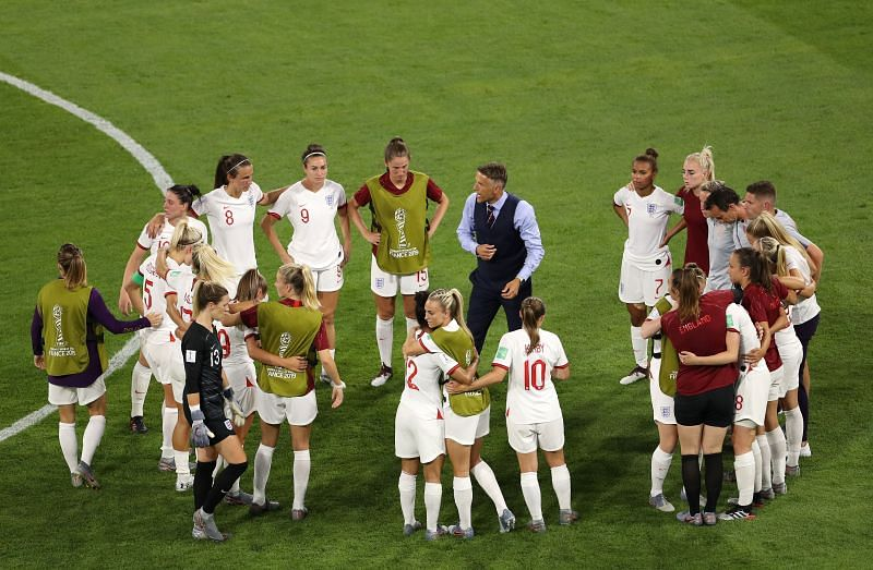 Neville addresses his players after the World Cup semi-final defeat to the United States