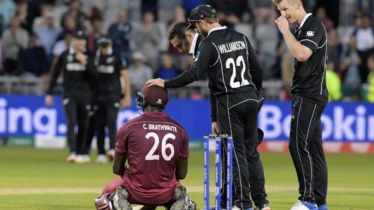 Carlos Braithwaite being consoled by Williamson after NZ