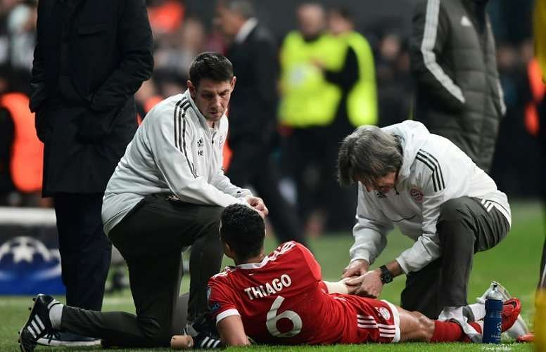 Alcantara is being checked by the medical staff for an injury against Besiktas in the Champions League.