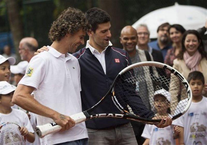 Novak Djokovic with Gustavo Kuerten in Rio de Janeiro in 2012