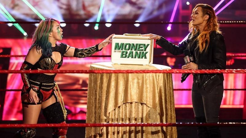 The Man made her entrance with the MITB briefcase