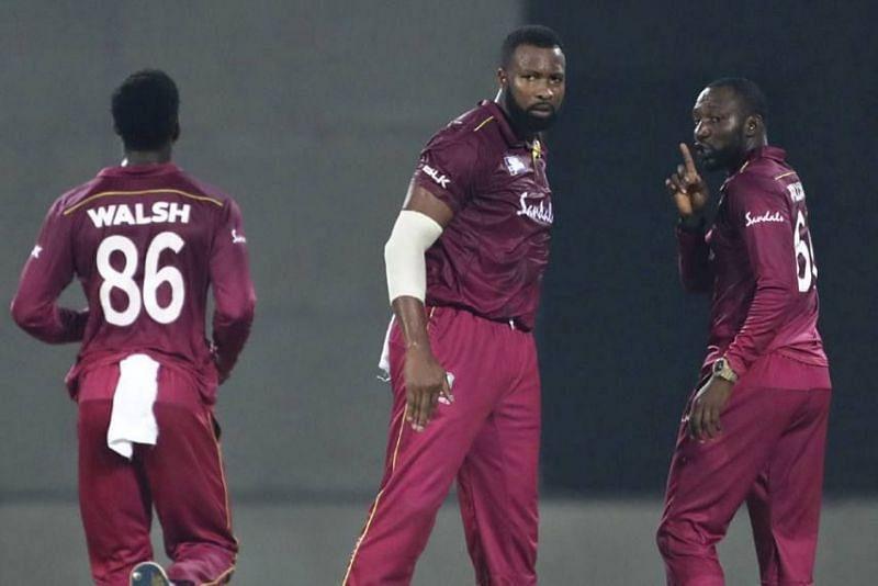 Kesrick Williams (right) along with West Indies T20 captain Kieron Pollard (centre)