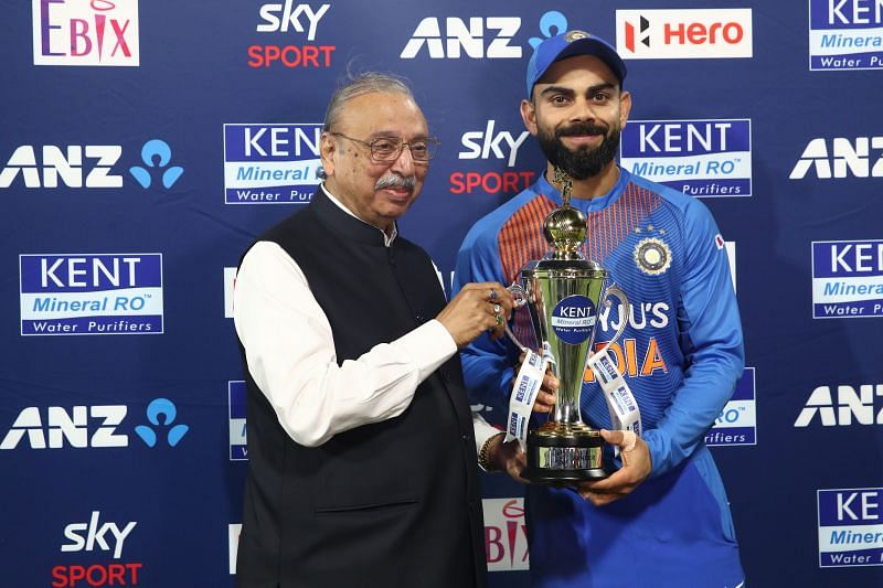 Virat Kohli (right) accepting the trophy after a T20 series win over New Zealand earlier this year