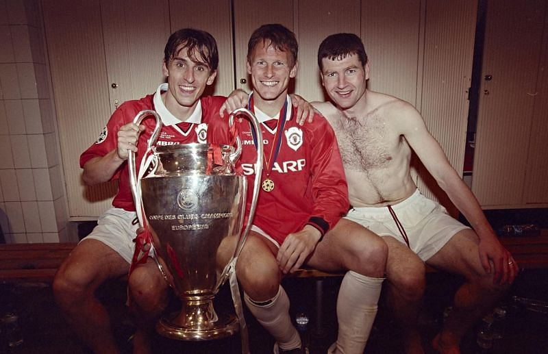 Gary Neville and Denis Irwin after the 1999 Champions League title