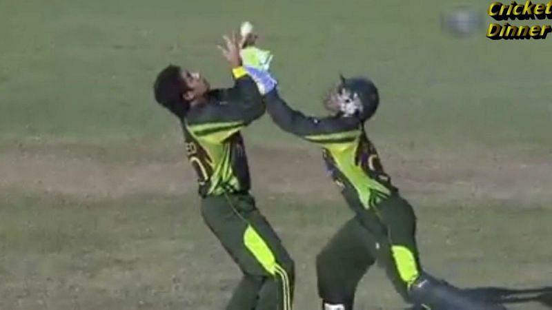 Umar Akmal and Saeed Ajmal going for the same catch