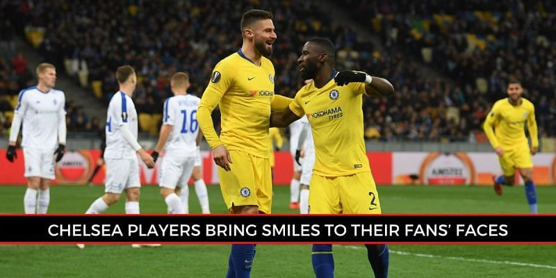 Giroud and Rudiger celebrate after scoring a goal