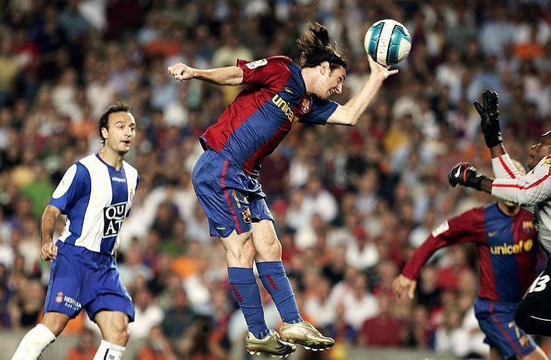 Lionel Messi scores with his hand against Espanyol