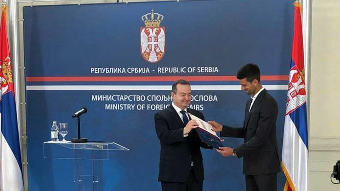 Novak Djokovic receiving a charter on the occasion of Diplomacy Day. (Image - Cordmaganize.com)