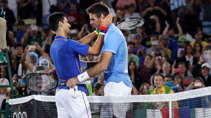 Novak Djokovic and Juan Martin del Potro embrace after the match