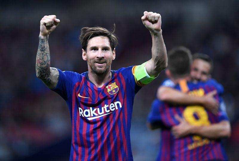 Lionel Messi celebrates after scoring a goal against Tottenham Hotspur