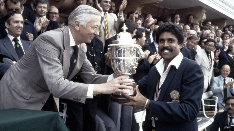 Indian skipper Kapil Dev collects the 1983 World Cup trophy