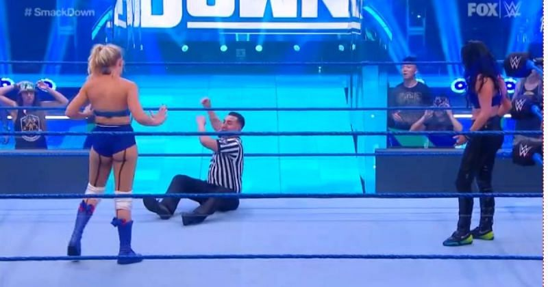 The referee called for help after Sonya Deville slid into his knee.