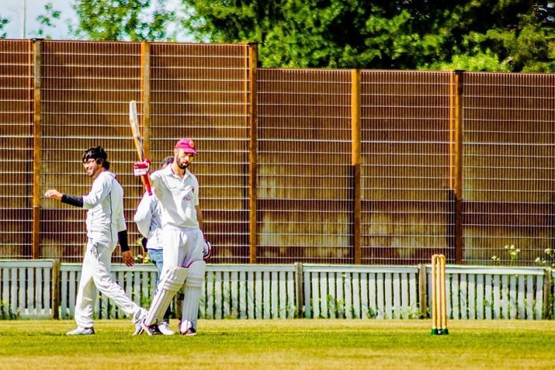 Nathan Collins raising his bat (Image credit: Cricket Finland on Facebook)