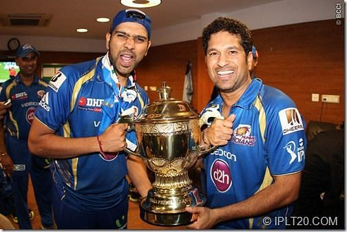 Rohit Sharma and Sachin Tendulkar with their first IPL trophy in 2013.