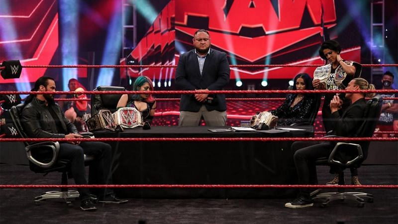 Samoa Joe curating a double contract signing