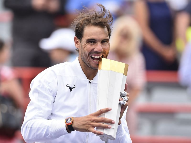 Nadal takes a bite of the Rogers Cup 2019 trophy - his fifth at the event