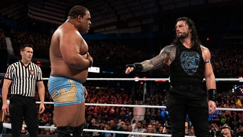 Roman Reigns and Keith Lee share a moment during Survivor Series 2019