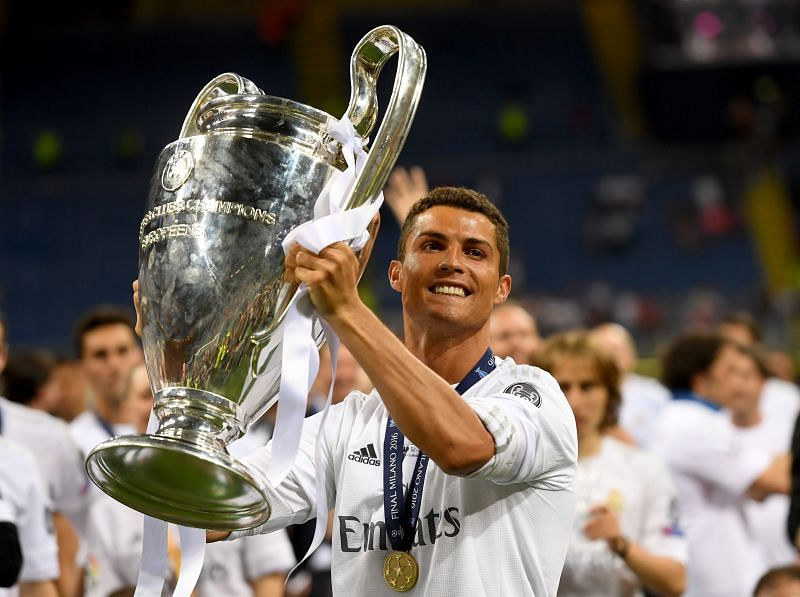 Cristiano Ronaldo celebrates one of his four Champions League trophies won with Real Madrid.