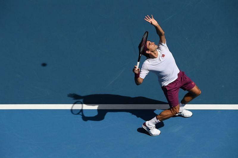 Roger Federer serves at 2020 Australian Open