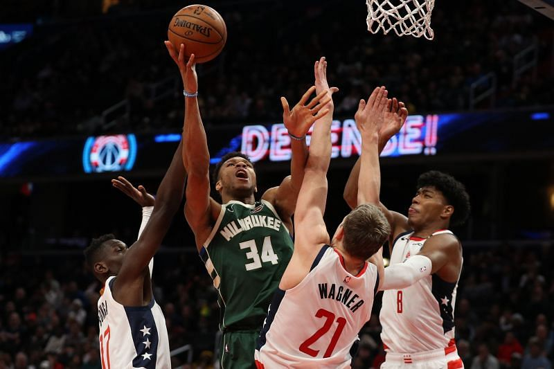 Giannis Antetokounmpo showing off his strength and athleticism