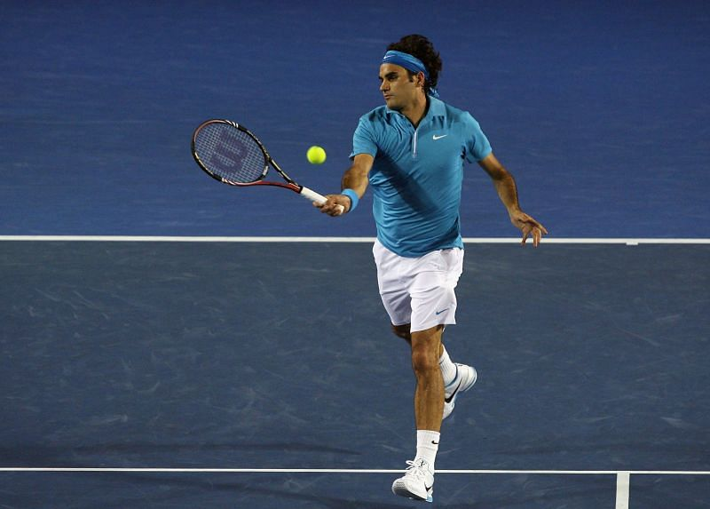 Roger Federer plays a swinging volley in the 2010 Australian Open final