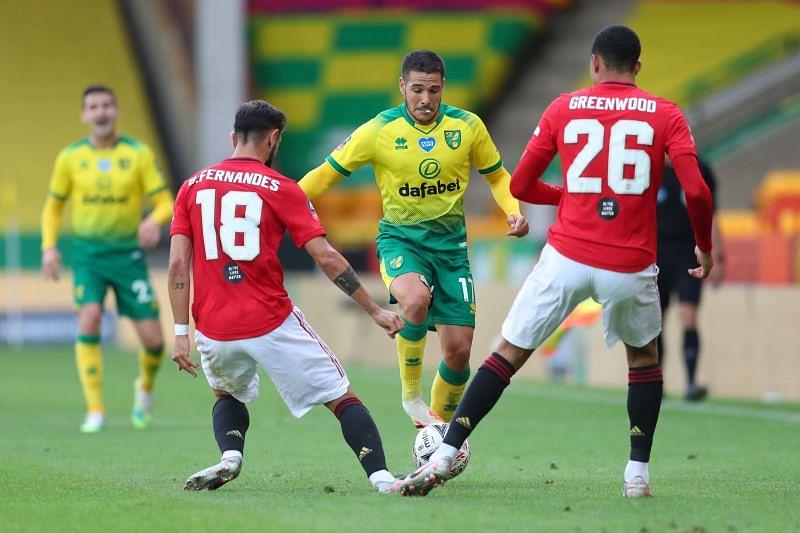 Emiliano Buendia takes on Bruno Fernandes and Mason Greenwood of Manchester United