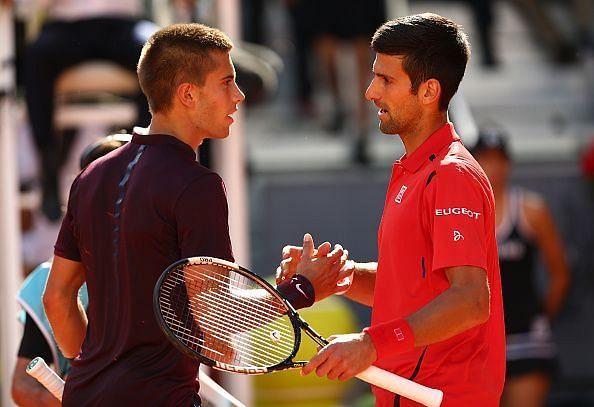 Novak Djokovic shakes hands with Borna Coric