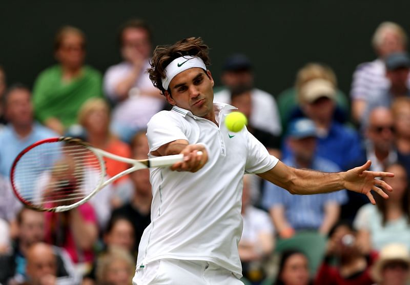Roger Federer plays a forehand at the Wimbledon Championships