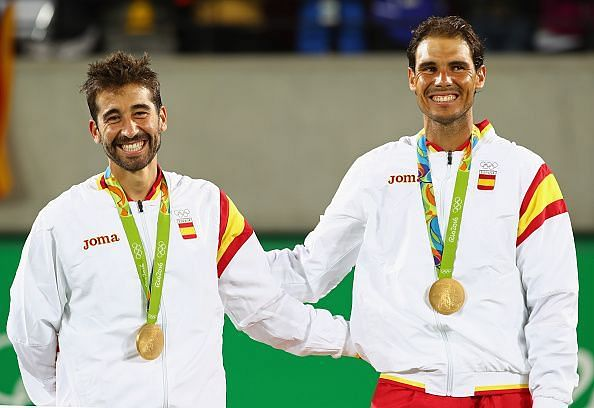 Marc Lopez and Rafael Nadal with their gold medals
