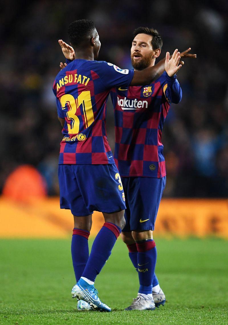 Lionel Messi celebrates a goal with Ansu Fati.