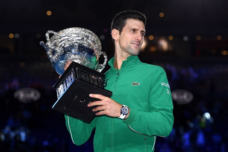 Novak Djokovic poses with the 2020 Australian Open title