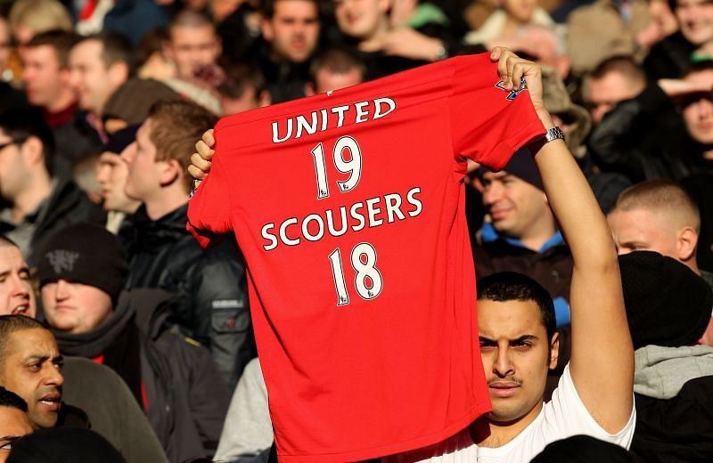 A Manchester United fan shows Liverpool their place. But things have since changed at Anfield.