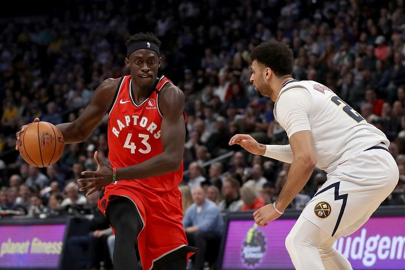 Pascal Siakam (left) in action for the Toronto Raptors.