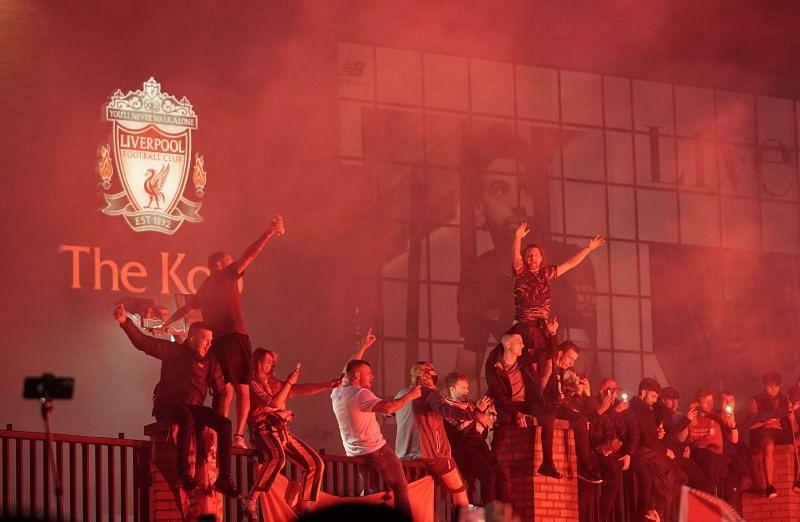 Fans celebrate as Liverpool lift the Premier League title at Anfield