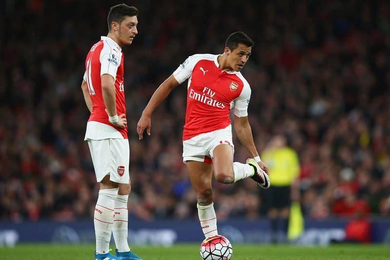 Mesut Ozil (left) and Alexis Sanchez